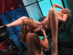 Two beautiful girls are having fun with dildos and tongues...