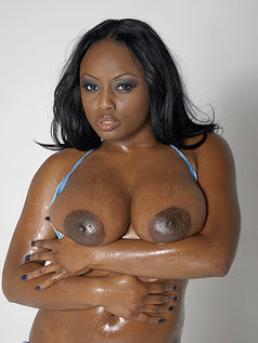 Smokin' Hot Ebony Beauty Jada Fire Lubes Up Her Big Tits And Puts On A Show In This Photo Set!