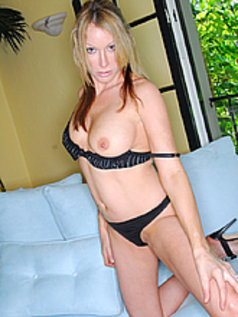 Hot as hellfire, Randi James, stripping and looking fine.