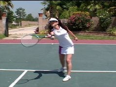 Elizabeth Lawrence plays with the tennis balls...