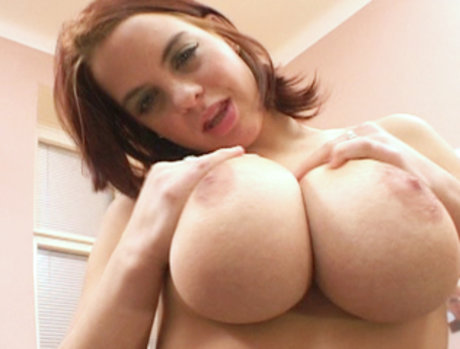 Mandy May gets those huge tits greased up for some real tittie action...