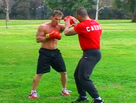 Coach Chris Steele is outdoors training with muscle hunk Caesar.