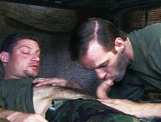 Michael Brandon takes charge of Christian Luke in this military-themed scene.